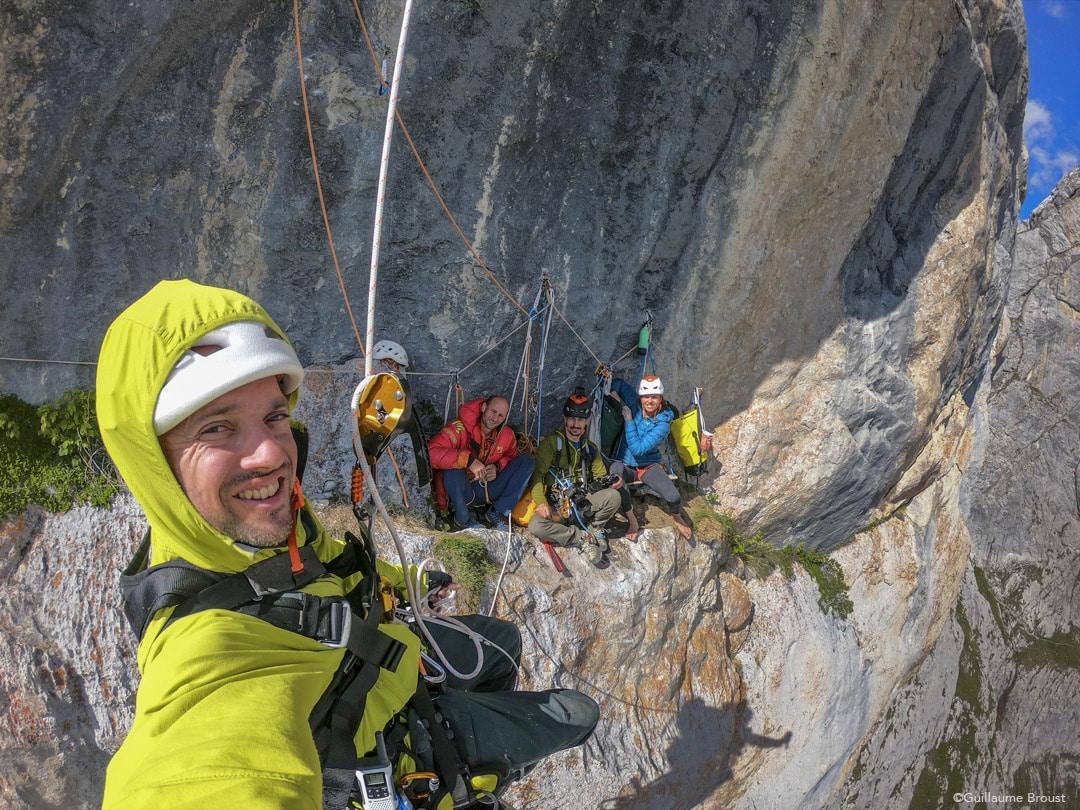 WoGü - The team has a break on the ledge of the 8c. Nina Caprez, Marc Daviet & Cedric Lachat ©Guillaume Broust